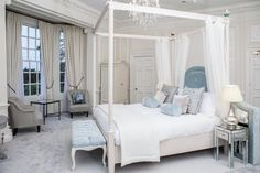 How beautiful is the white four poster bed in the bridal suite at wedding venue Hedsor House?