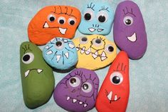 GREAT project for a weekend 1.) take your kids out hunting for great rocks 2.) wash them 3.) paint them 4.) glue eyes on 5.) let them draw teeth (and paint in with white)