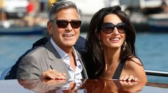 The newlyweds were spotted soaking up the sunshine at Clooney's El Dorado Beach Club in Los Cabos, Mexico, reported E! online. (Source: AP)