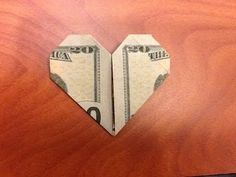 A heart from a dollar bill. This model has been used for breast cancer awareness with people wearing the design from a five dollar bill as a pin. Origami Love Heart, Origami Star Box, Origami Stars, Origami Flowers, Origami Boxes, Origami Heart Instructions, Origami Tutorial, Dollar Bill Origami, Money Origami