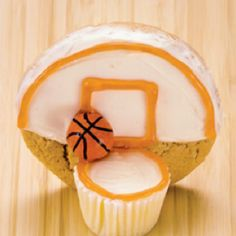 Cookie and cupcake into basketball hoop.