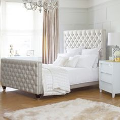 St Jorge Bed - From £1580 Melt into this deep buttoned St Jorge Bed executive bed. Lose yourself against the soft luxury fabric and feel alive on its elegant structure. On this bed, you won't just fall asleep; you will begin to dream. Live, love and live again on this exclusive Handmade in London creation. With silver studding and dark contrasting feet, this bed won't just add to your room; it will complete it. Photographed here in our Luxury Linen - Accents Dove.