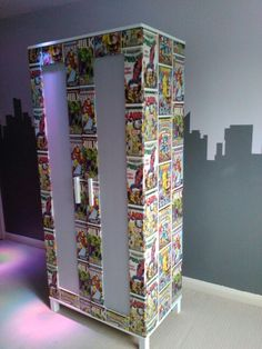 Custom marvel wardrobe. Just a normal Aneboda Ikea wardrobe that I jazzed up with a 10m marvel wallpaper roll, wallpaper paste and a staple gun.