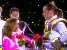 Tommy and Kimberly are given red roses in order to brack an evil spell that turned them against each other Tommy turns and looks at Kimberly l'm so sorry he said l'm so sorry too Tommy said Kimberly with a smile to one another they make up Kimberly Power Rangers, Pink Ranger Kimberly, Pink Power Rangers, Kimberly Hart, Amy Jo Johnson, Tommy Oliver, Mighty Morphin Power Rangers, Favorite Tv Shows, Red Roses