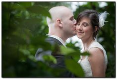 Nice use of foliage in the foreground to frame the couple.
