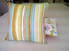Cushions in tanglewood marmalade fabric decorated with plain lime green cotton designed by kidsfabrics.co.uk