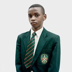 Swiss-born Claudio Rasano's Portrait of Katlehong Matsenen, winner of the 2016 Taylor Wessing Photographic Portrait Prize. The image comes from Rasano's series 'Similar Uniforms We Refuse to Compare', which captures students of a Johannesburg high school.