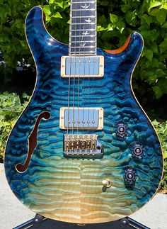 Custom PRS guitar in Iceberg Dragonsbreath finish. Created using the finest tone woods that also happen to look.... AWESOME!!