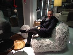 Our smiling agent #AndreaCalandrin of #CalandrinAssociati seats on #Chummy #Fuzzy #armchair #synthetic #fur
