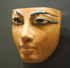 Ancient Egyptian funerary mask, painted wood, about 1400-1300 BC, end of 18th dynasty. Louvre