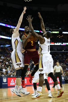 Kyrie Irving #2 of the Cleveland Cavaliers shoots the ball over Tyreke Evans #1 of the New Orleans Pelicans at Smoothie King Center on December 12, 2014 in New Orleans, Louisiana.