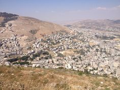 Mount Ebal (across), Shechem (see ruins in the valley between the two mountains), Sychar (top right) from the view of Mount Gerizim. This is where Jesus met the Samaritan woman at the well (bottom right). This is the location of Joseph's tomb. And from Mount Ebal and Mount Gerizim the Israelites proclaimed the blessings and curses of the Mosaic Covenant.