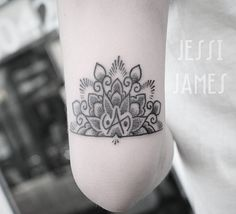 Little half mandala and balance symbol above the elbow tattooed whilst visiting…