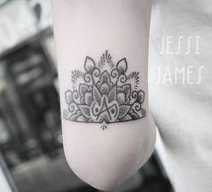 Little half mandala and balance symbol above the elbow tattooed whilst visiting @ninelives_studio #dotwork #blackwork #tattoo #blacktattoos #dotworktattoo #darkartists #bestofbritishtattoo #ukbta #tribalkulture #blackndark #blackworkerssubmission #btattooing #blacktattooart #blacktattoomag #afterinked #uktta #taot #inkstinctsubmission #onlyblackart #blackink #equilaterra #tattrx #mandala #mandalatattoo #balance