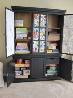 I don't like the black but the idea of a beautiful boardgame cupboard sounds awesome - Game Storage