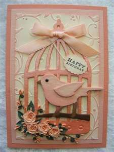 hand crafted card ... beautiful coral pinks ... large die cut bird cage ... sweet punched bir with a bit of a wing trim ... gorgeous grouping of paper roses ... beautiful card ... Stampin' Up!