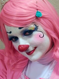 Pink cutie clown face painting by Painted Mistress