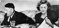 How Did Hitler Kill Himself?: German dictator Adolf Hitler and his mistress Eva Braun dine in a still from a private home movie made by Braun's sister Gretl Fegelein. (circa early to mid 1940s)