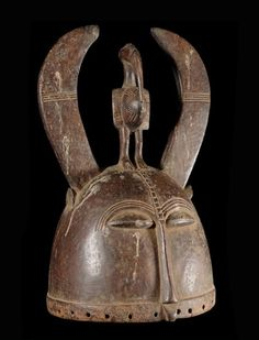 Helmet mask bird sacred Senufo are riding