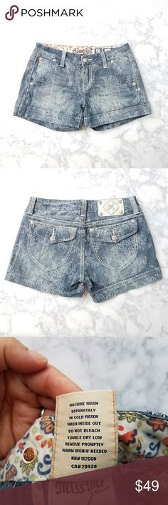 """Miss Me Shorts Super cute Miss Me denim shorts with a lace print and silver button details.  Approx measurements: waist 28"""", hip 38"""", inseam 3"""", front rise 8"""", back rise 12.5"""".  Color is """"Indigo Lace."""" Miss Me Shorts Jean Shorts"""