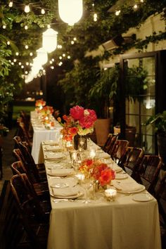 Check out this beautiful nighttime garden terrace dinner party! Great use of space and color.