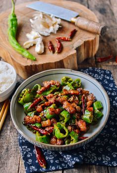 Sichuan Three Pepper Pork Belly Stir-fry uses crispy chunks of pork belly with three peppers - Dried red peppers, Sichuan Peppercorn, and Long green peppers