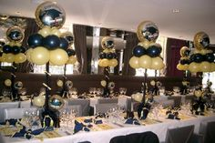 graduation party decoration. black and gold party decorations and table centerpieces.