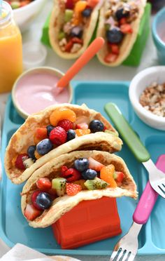 With a rainbow fruit salad, yogurt drizzle, and sprinkle of chopped nuts, Rainbow Pancake Tacos make for a fun new breakfast idea!
