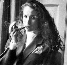 Andi McDowell smoking a pipe