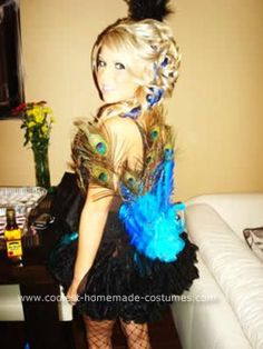 Homemade Peacock Adult Halloween Costume Idea: This is my fabulous Peacock Adult Halloween Costume Idea:! I bought a black corset and covered it in black feathers, then I went over the black feather