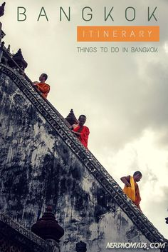 Three monks on their way down Wat Arun/ Temple Of The Dawn. Check out what else you should not miss when heading to Bangkok - Our Three Day #Bangkok Itinerary: http://nerdnomads.com/what-to-do-in-bangkok