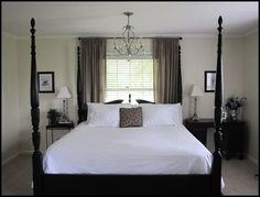 Lovely. Follow the link for a great before/after Master Bedroom makeover done on a budget of $700 (from selling the furniture previously used in the room).