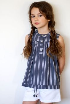 Love the stripes. I have some very similar fabric in red and in green. May have to knock this off for a summer dress and eventual tunic/top for Naomi.