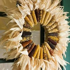 Love the texture of this corncob wreath. This could look like a beautiful giant sunflower if made with the same color corncobs, especially the dark colored ones