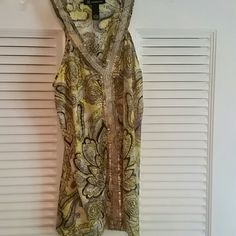 Top Sleeveless, racerback, embellishments around neckline and down front. Very cool, comfortable material. No beads missing. Excellent condition. INC International Concepts Tops Tank Tops