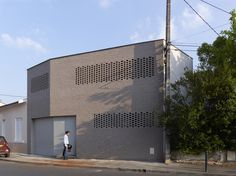 Built by FABRE/deMARIEN Architects in Bordeaux, France with date 2012. Images by Stéphane Chalmeau. A house as a filter between a busy street and a quiet garden.   From the street, some steps and a brick façade as a p...