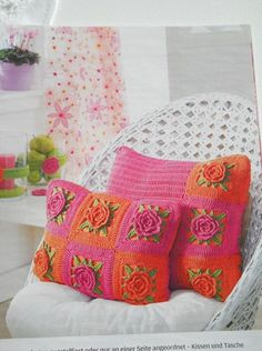 .pink and orange flower pillows. Patterns in chart form only.
