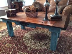 Here is a coffee table that is made from repurposed pallet wood and reclaimed wood! It is distressed in teal blue/black shabby shic with a rich