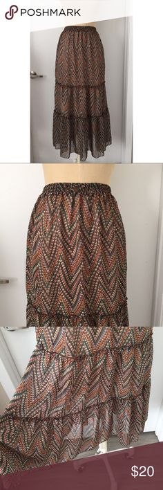 Olive & Oak Boho Chevron Maxi Skirt 25B Size small! Super stretchy elastic waist band. Could fit up to a M and down to an XS. Groups sheer chevron print. Goes with every neutral or jewel tone color you could think of! I wore this all the time in high school and college and got soooo many compliments! I no longer have use for it but it's gorgeous! It deserves to be worn again rather than sitting in my closet! Offers welcome, bundle and save! Olive & Oak Skirts Maxi