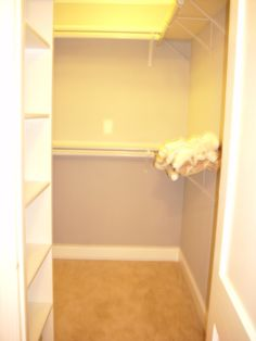 Walk in closet with organizational system added.