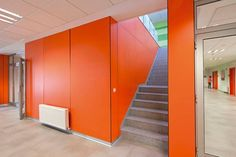Wall panelling for vivid interiors using Clementine from our Colors range of laminates http://buzz.mw/b1qle_n #orange #interiordesign