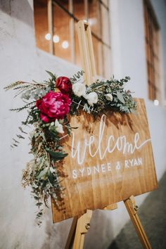 Burgundy flowers work so well on wedding signage. These classic burgundy peonies work so well with this green foliage. Amaranthine Blooms luxury artificial peonies are perfect imitation flowers. Guests will never know the difference!