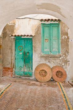 a blue door and window in Cetara, a small town along the Amalfi Coast.