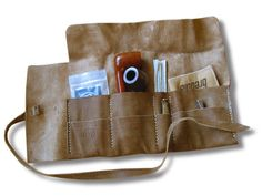 This is a roll-up pipe bag that will help you carry your pipe and your necessities in a stylish way. It is an avant-garde, non-standard leather pipe pouch at this pouch you can put many accessories, the leather is very soft but durable, the pouch is 100 % hand made - 1 pipe loop - 1 long pocket for pipe cleaners - 1 loop to hold your tobacco pouch - 1 pocket for filters Height :15.7 (40 cm) Top Width : 23.6 (60 cm) Depth :3.9 (10 cm) materials: leather colors: brown / red / black