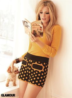 Blake Lively reads in retro fashion. Glamour, July 2011. Lively wears a sweater by Marc Jacobs and shorts by M Missoni. Her accessories include earrings by Miriam Salat and a cuff by Oscar de la Renta. She readsChéri, a novel by Colette, first published in French in 1920.