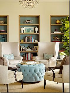 Aqua shelves mixed with framed photographs and white vases.  Try not to use a lot of small photographs or tiny objects – it will must make your shelves look cluttered and messy.  Using larger accessories makes much more of an impact.