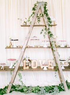 Transform an old ladder into the perfect reception decor! http://www.stylemepretty.com/california-weddings/2016/01/21/an-event-coordinators-dreamy-organic-romantic-backyard-wedding/ | Photography: Daphne Mae - http://www.daphnemaephotography.com/