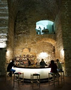 Kursaal Kalhesa Restaurant, Caltanissetta, Italy.    A restaurant built within Palermo's ancient walls, where chariots were once housed. Under these enormous vaults there is a library, a garden, and a bar—it's a fantastic place for drinks