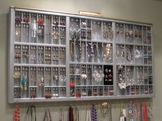 Repurposed antique printer drawer, now a wall jewelry organizer, in silver and gold. LOVE!!!