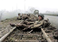 GIs of the Infantry Regiment, Infantry Division 'Timberwolf Division' are pictured resting on railway tracks after combat in North Rhine-Westphalia, Germany on December The photo was captured during the Battle of the Bulge Military Photos, Military History, Us Army Soldier, Timberwolf, Vietnam, Ardennes, American Soldiers, Gi Joe, World War Ii